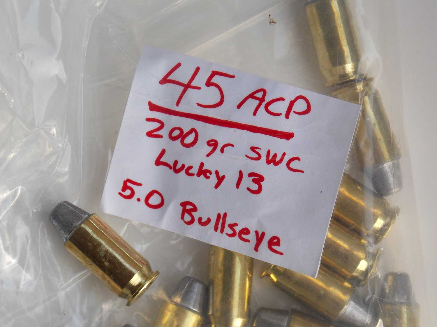 .45 ACP bullets in a plastic bag with red label