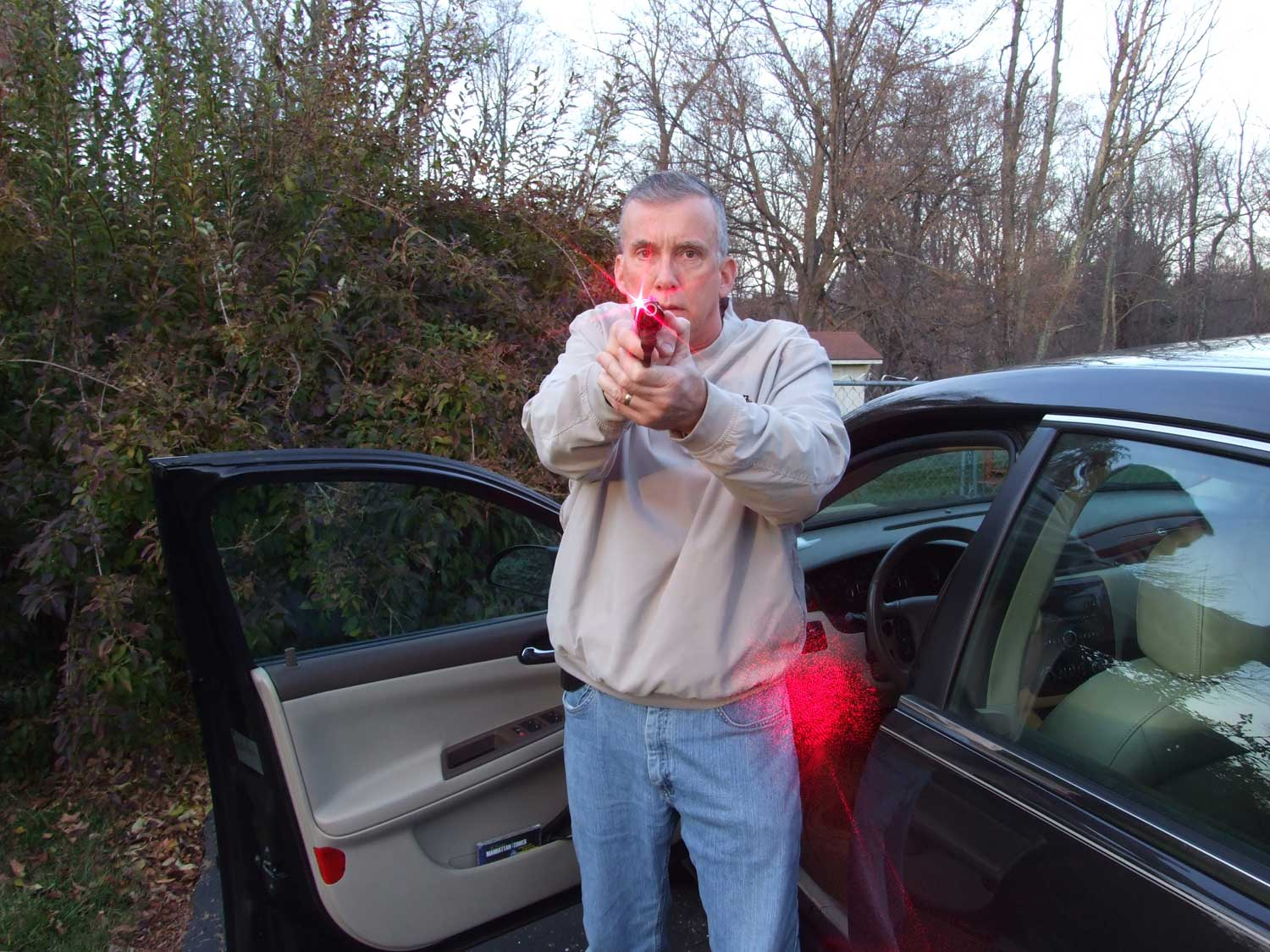 Scott Wagner standing in front of a car door with a Smith and Wesson .38 Bodyguard pistol