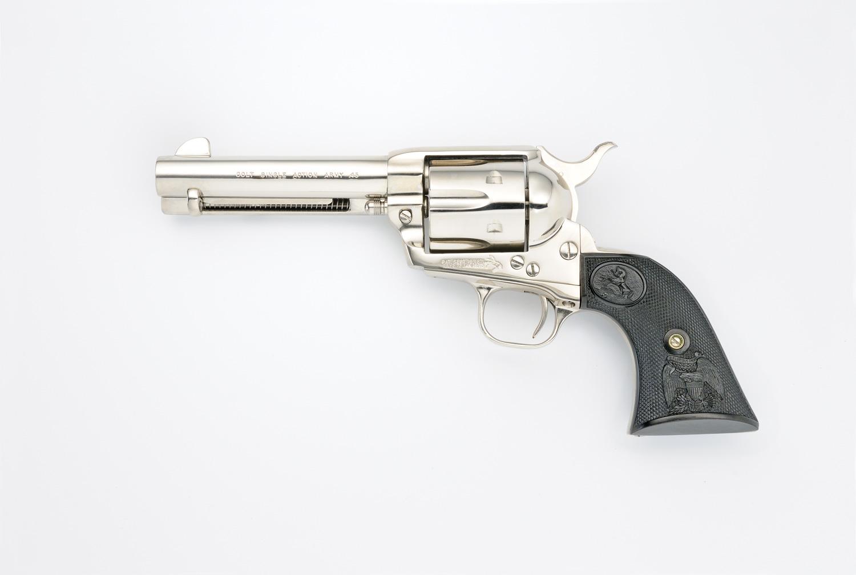 Colt SAA with 4 ¾-inch barrel, chrome left side