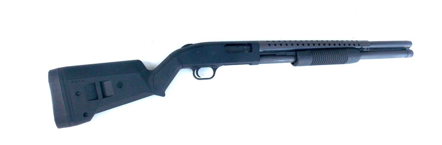 Mossberg 500 shotgun right with Magpul SGA stock