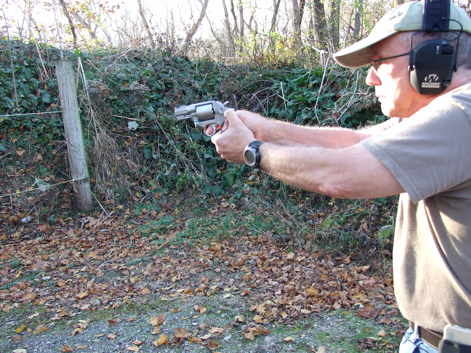 Scott Wagner shooting a revolver outdoors