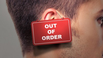 Man's face with out of order sign on his ear