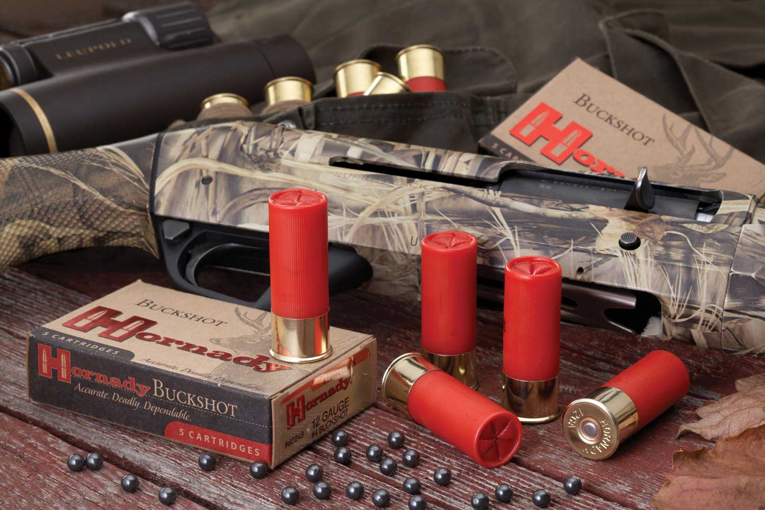 Hornady buckshot 12 gauge shells with camouflaged shotgun