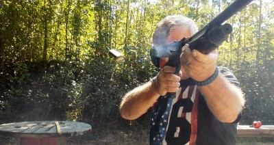 Bob Campbell shooting a semi automatic shotgun with two shells in the air