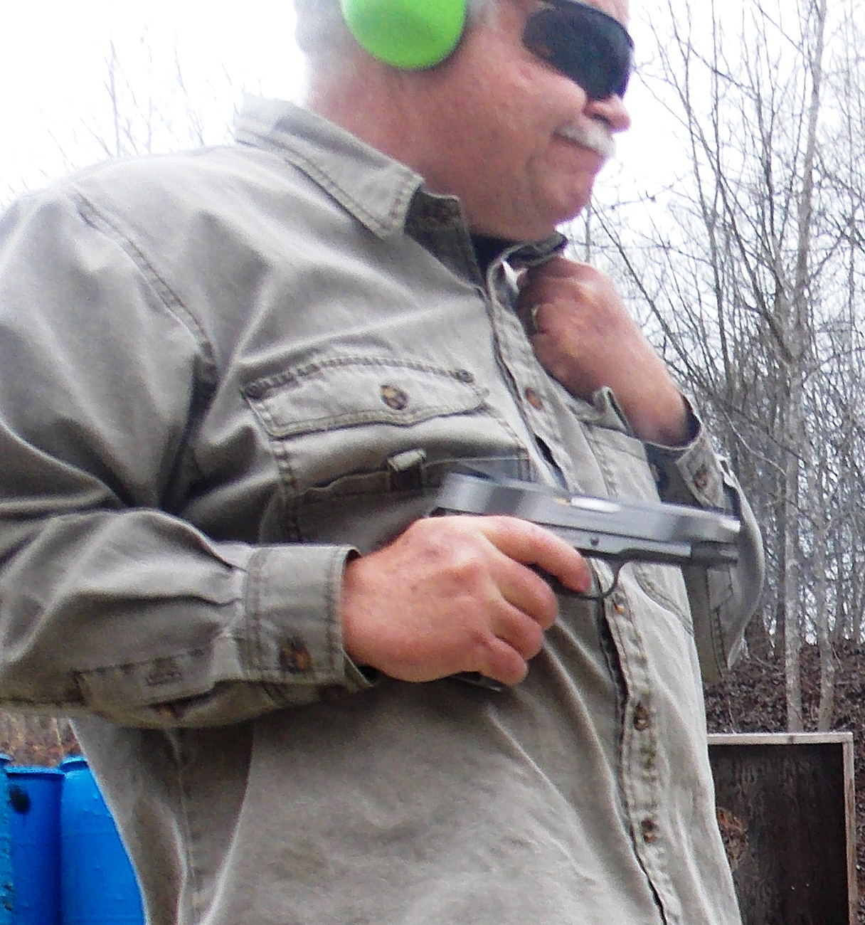 Bob Campbell shooting a 1911 pistol from a retention position