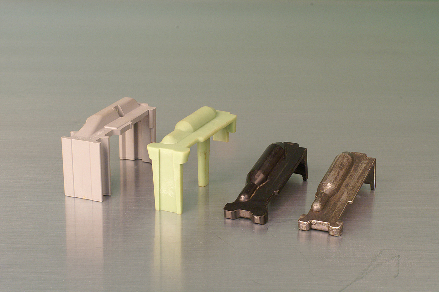 "Four magazine followers Magpul, ""green,"" ancient Colt metal, newer Colt plastic"