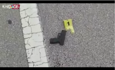 Gun in street with evidence marker