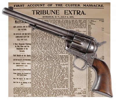 Colt Single Action Army over 1876 newspaper
