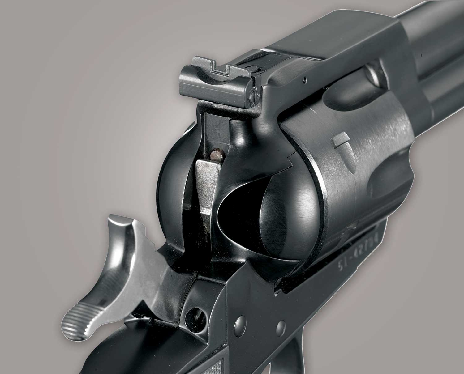 Transfer bar on a revolver handgun