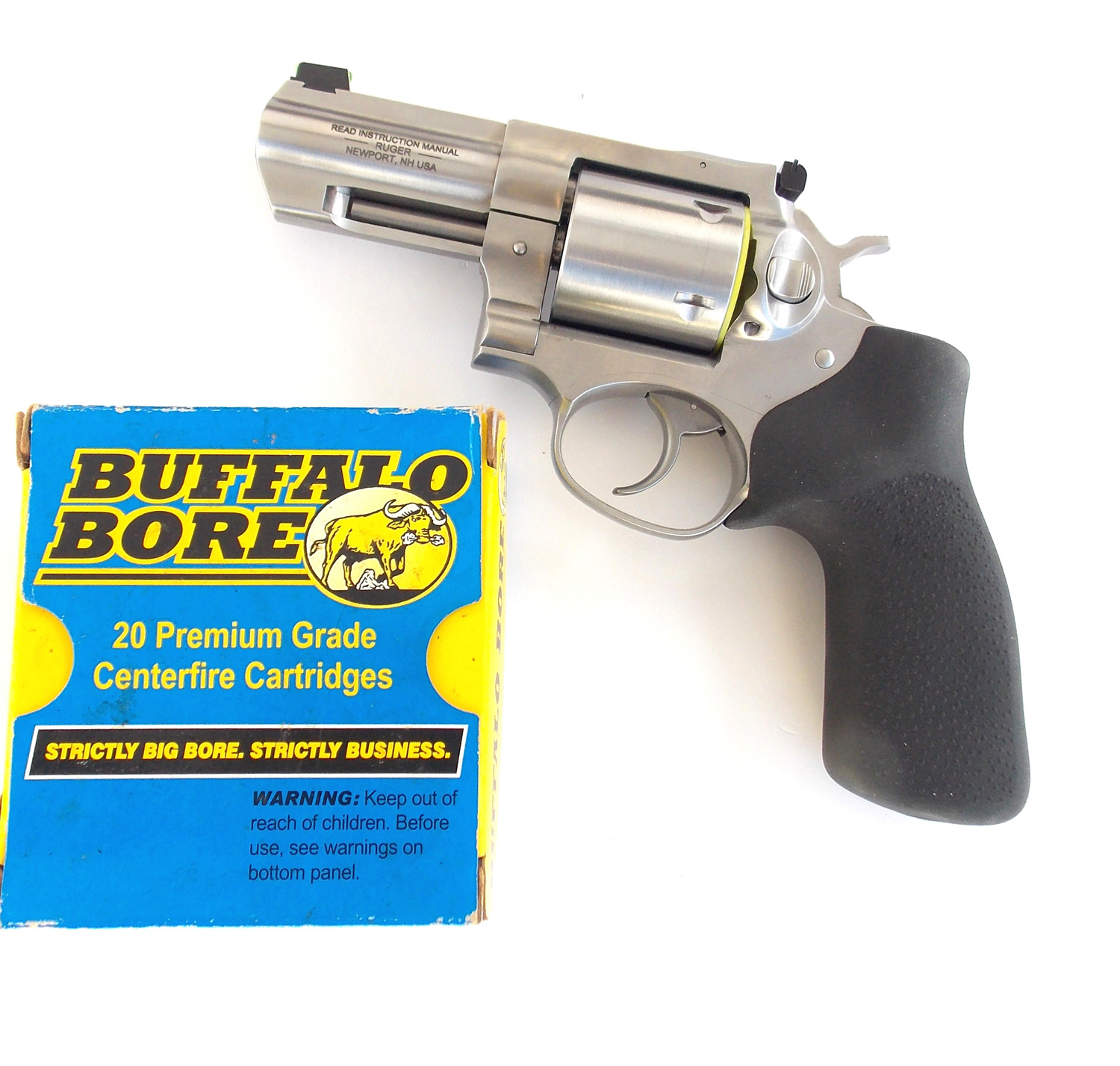 Ruger GP100 revolver with box of Buffalo Bore ammuniton