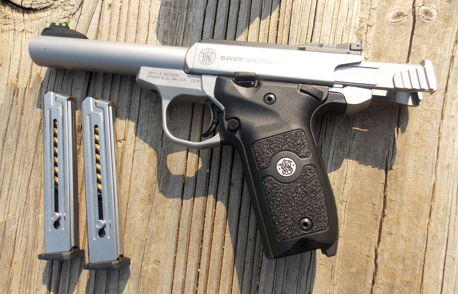 Smith and Wesson Victory 22 pistol with slide locked back and two magazines