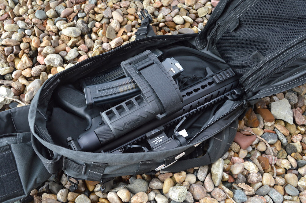 SIG MPX pistol folded into a backpack