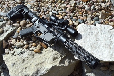 Assembled AR-15 pistol on bed of rocks