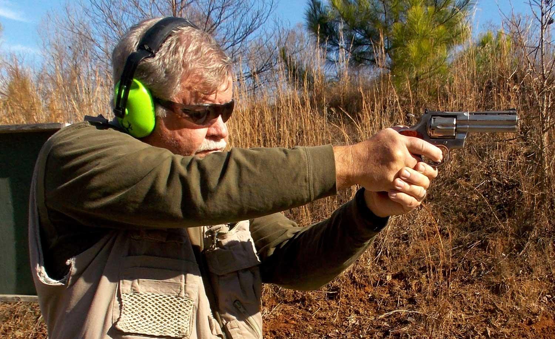 Bob Campbell shooting a revolver