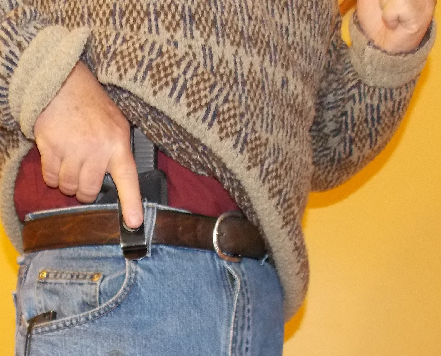 Demonstration of the draw technique using appendix carry of a firearm