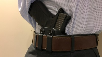 Holstered pistol in an inside the waistband holster