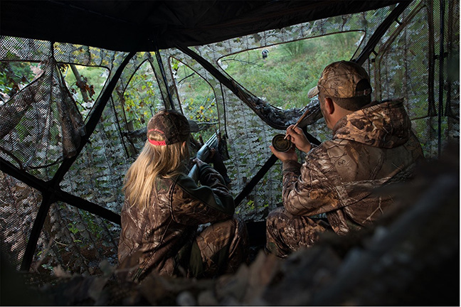 Two turkey hunters in an Ameristep ground blind