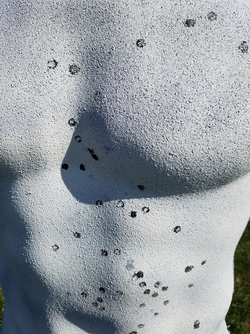 Close up of Rubber Dummy Target with multiple bullet impacts
