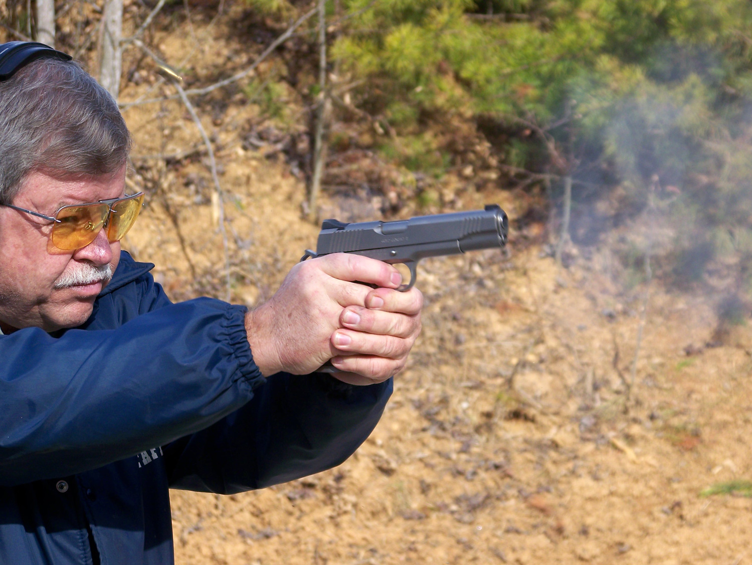 Bob Campbell shooting a pistol