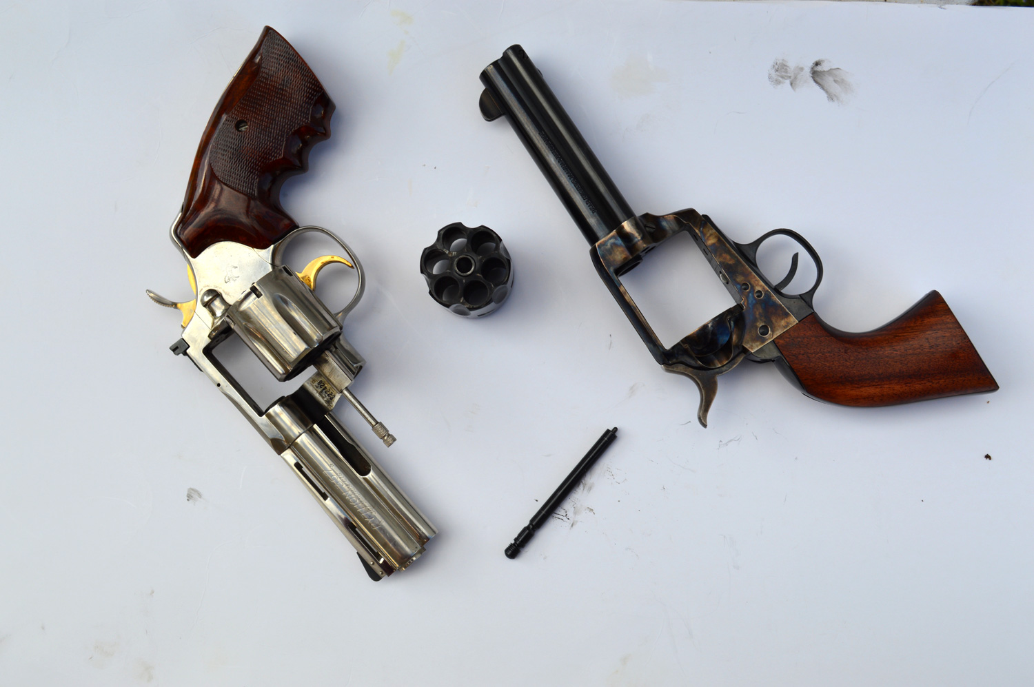 Two revolvers, one with the cylinder removed