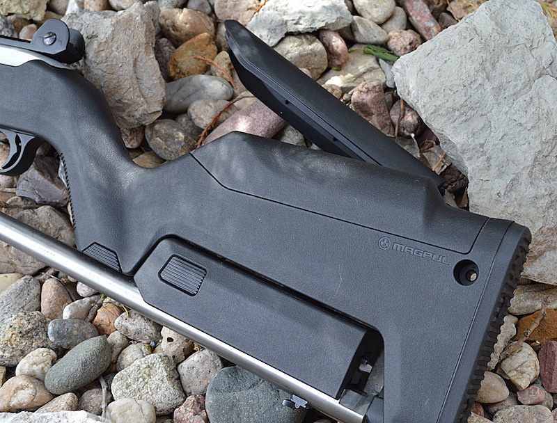 Magpul X-22 Backpacker stock with handguard inserted and barrel breech inserted into the rubber key hole
