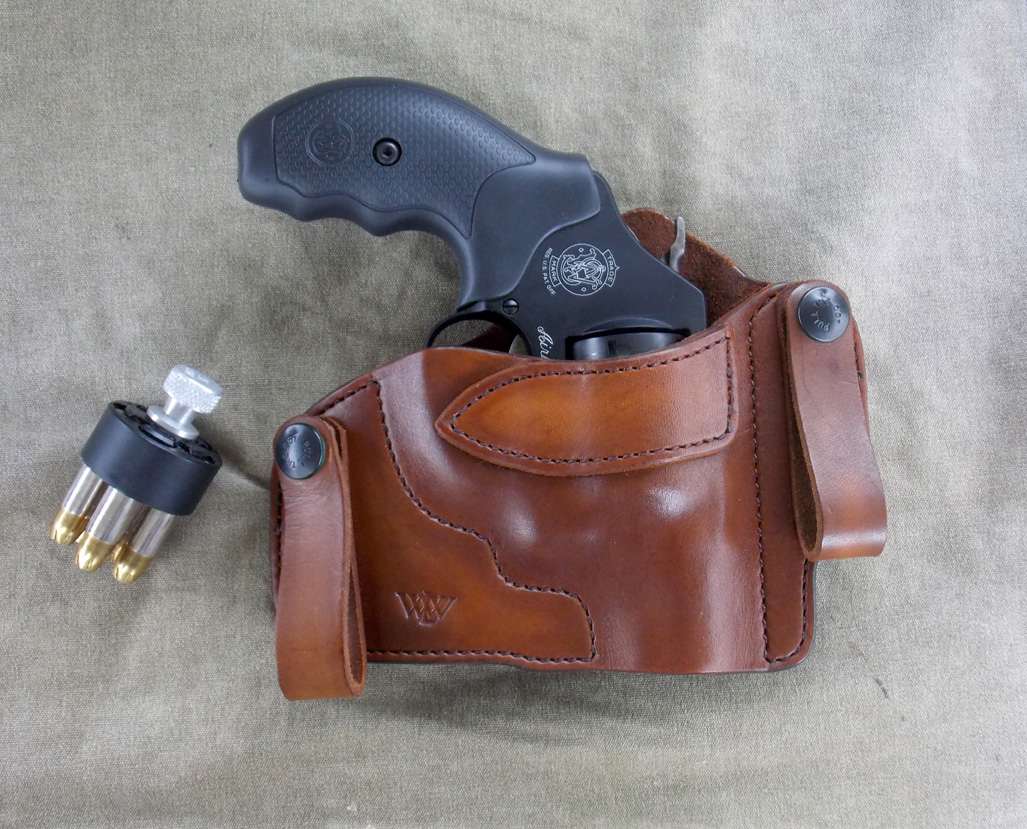 Revolver in a Wright Leatherworks holster with a speedloader