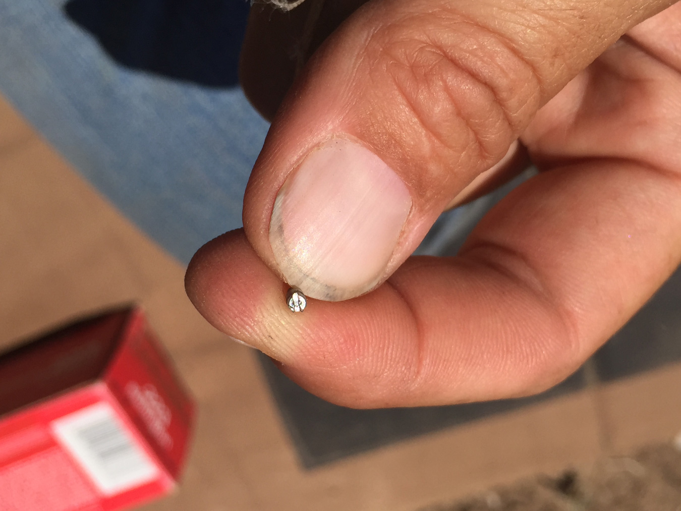 Holding a very small riflescope screw