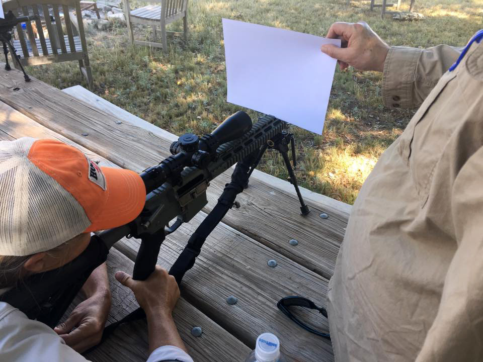 Holding a sheet of white paper in front of a riflescope