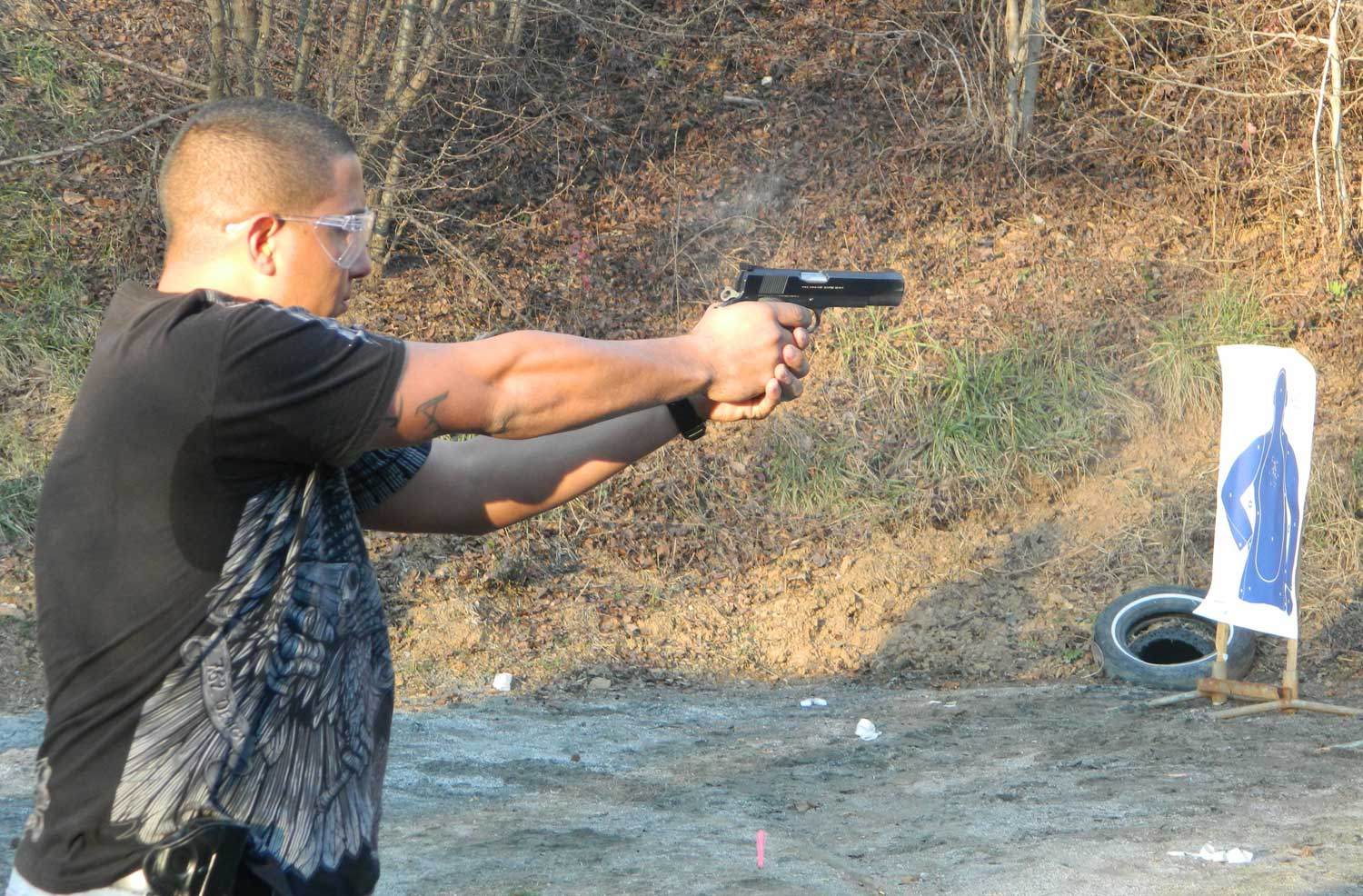 Man shooting a 1911 pistol in a concealed weapon permit class.
