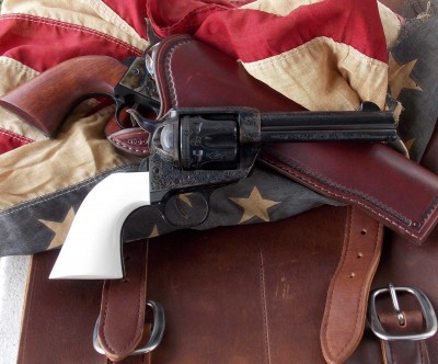 Traditions Liberty revolver right profile on leather holster and American flag