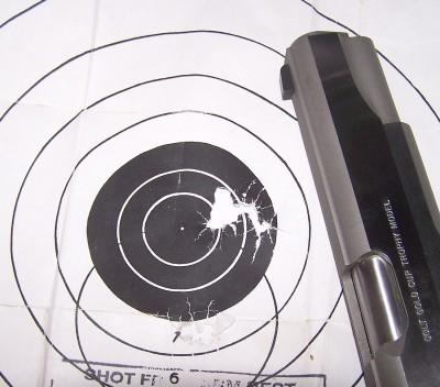 Colt Gold Cup pistol on a bullseye target