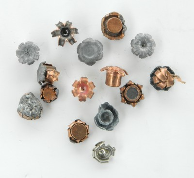 Several expended handgun bullets