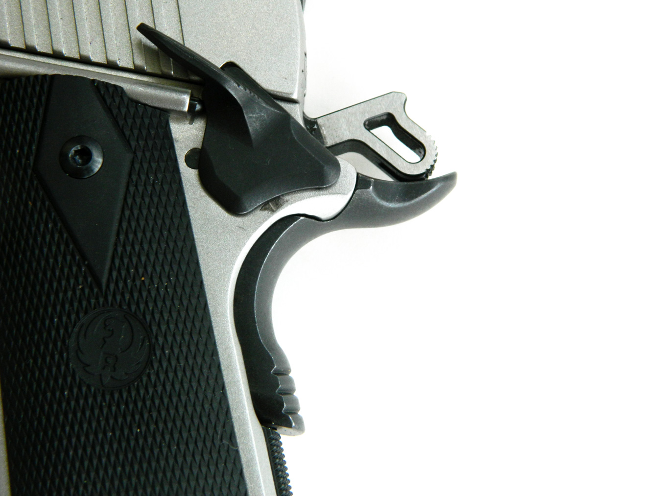 Custom-grade beavertail grip safety and extended slide lock safety on the Ruger SR1911 10mm pistol