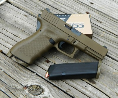 GLock pistol atop a box of 9mm ammunition