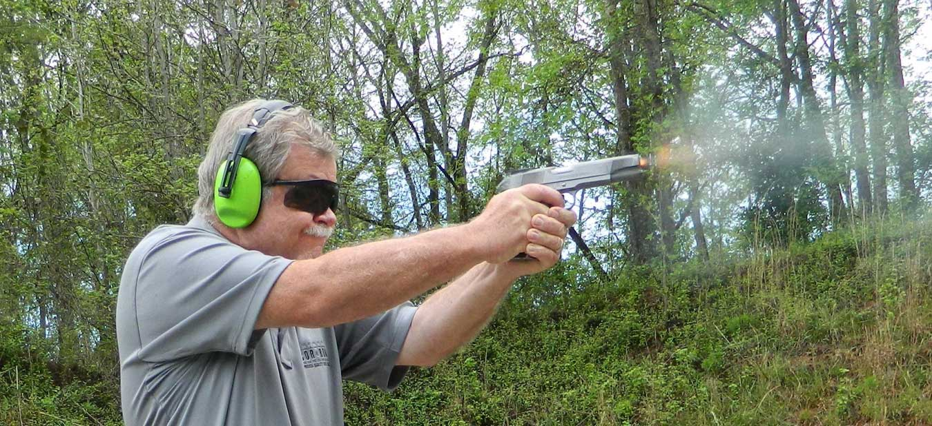 Bob Campbell firing a 1911 .45 ACP pistol
