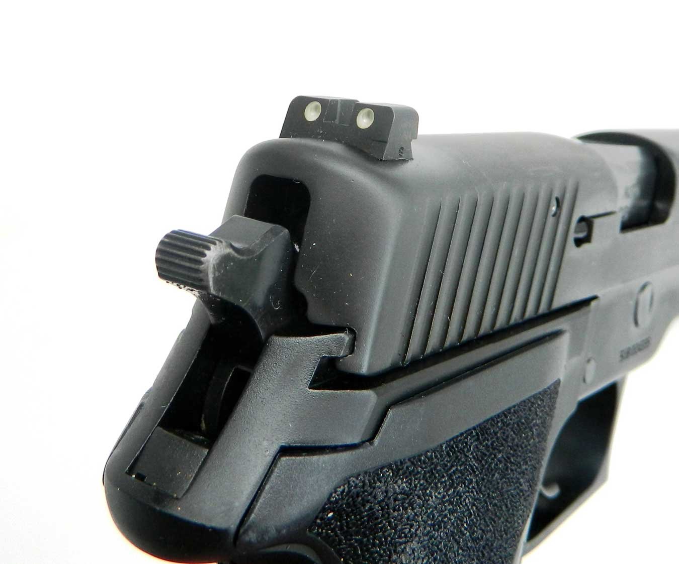 NIght sights on a SIG P227 SAS pistol