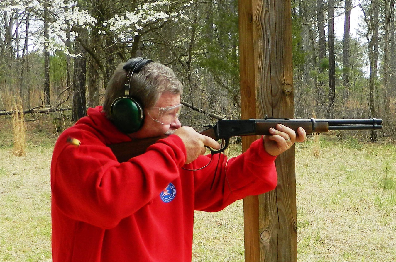Bob Campbell shooting a lever-action rifle.