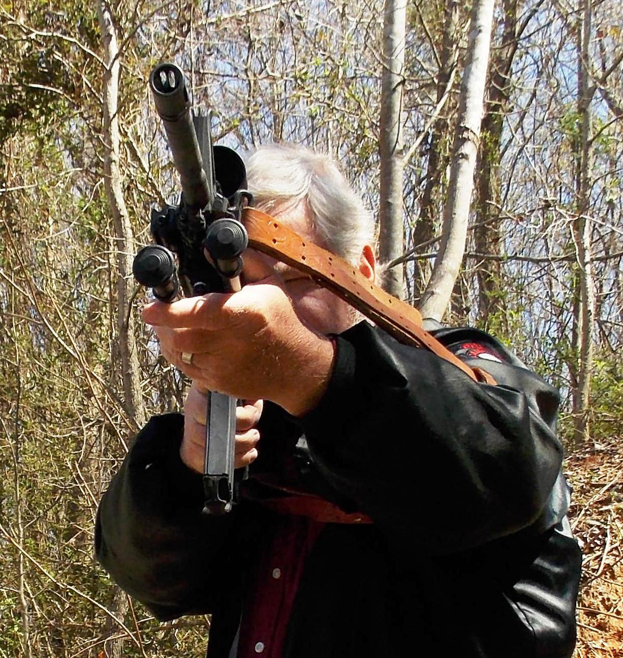 Bob Campbell shooting a rifle with a sling