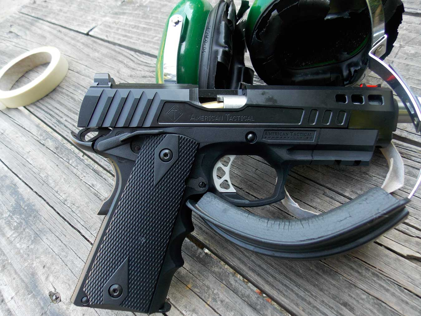FXF-45 pistol atop a pair of ear muffs