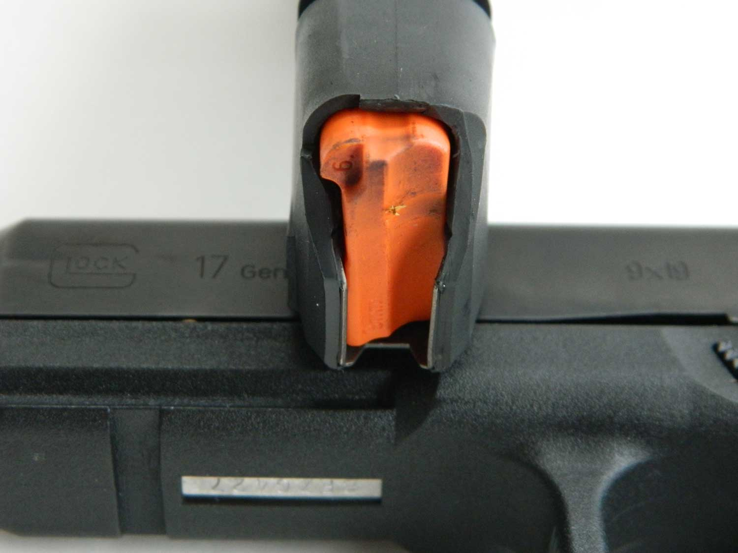 Orange pistol magazine follower