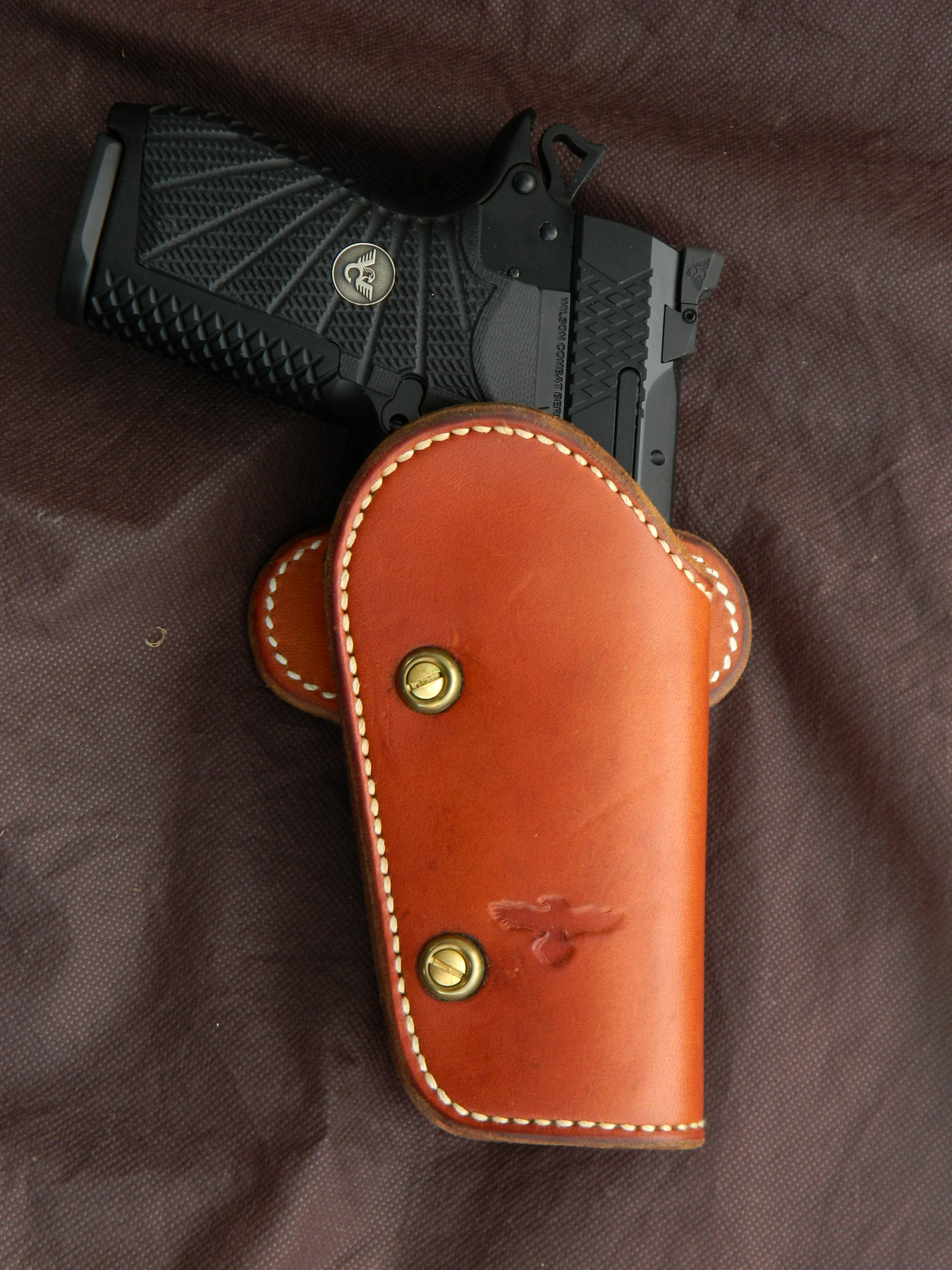 Wilson Combat EDC X9 in a brown leather holster