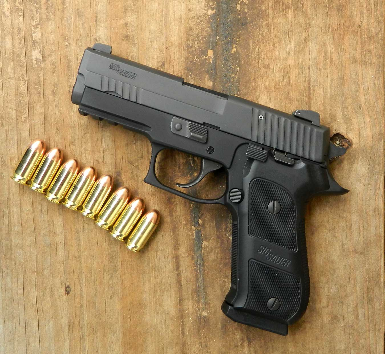 SIG Sauer handgun and several rounds of ammunition