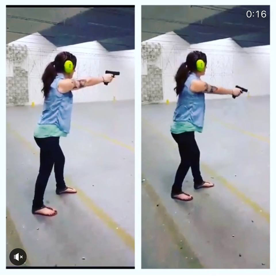 Woman demonstrating shooting drills