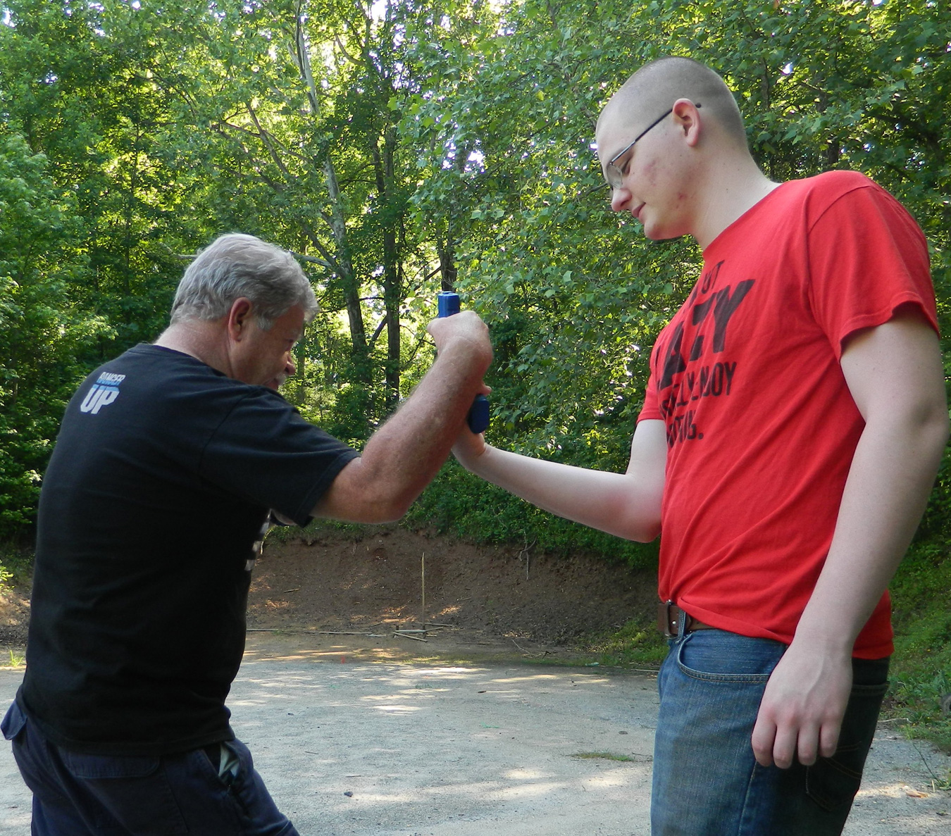 INstrustor demonstrating how to disarm a suspect