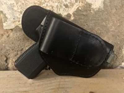 Side view of the JM4 Tactical QCC holster, black