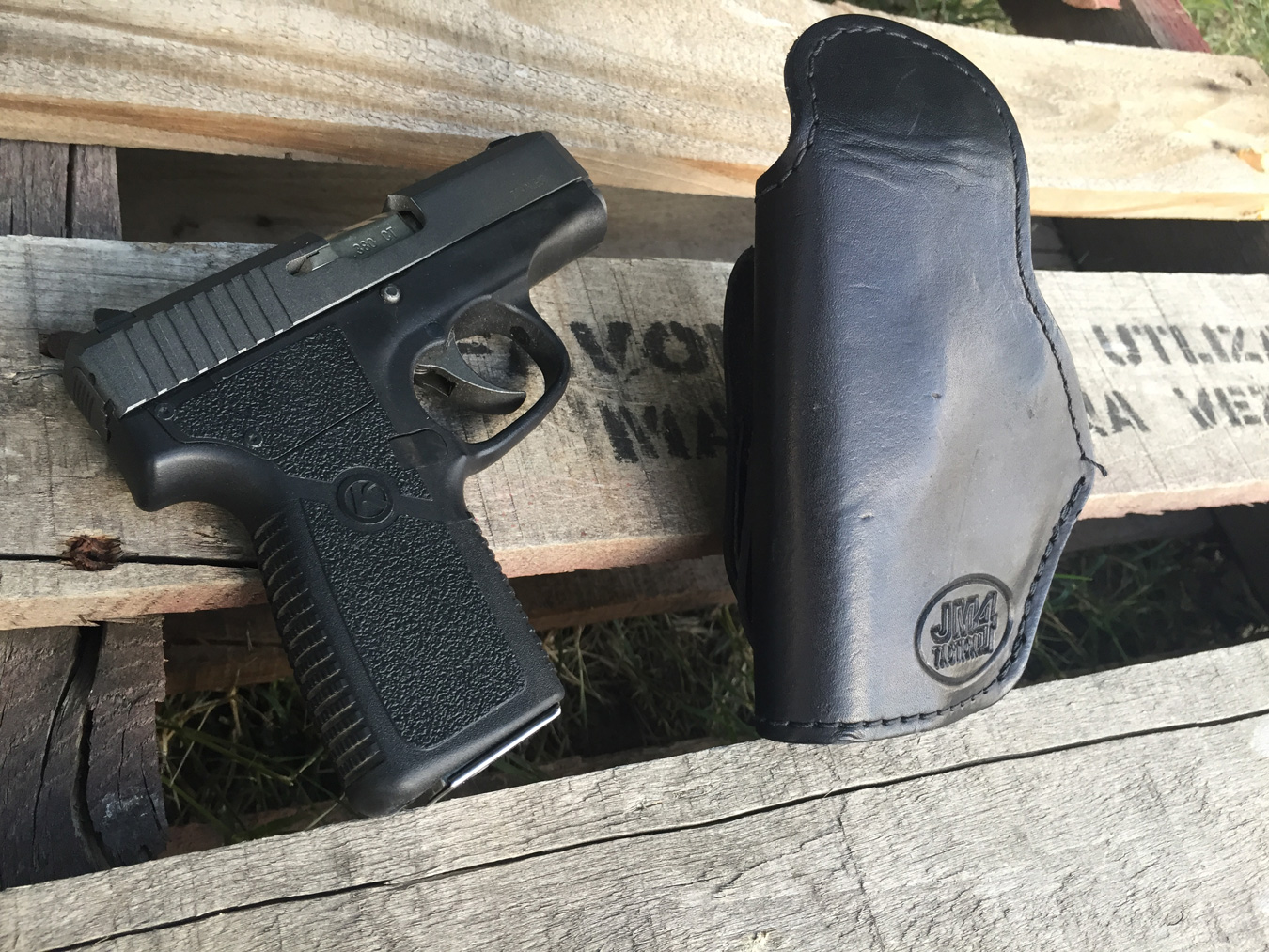 Kahr 380 pistol with JM4 leather Quick Click & Carry holster