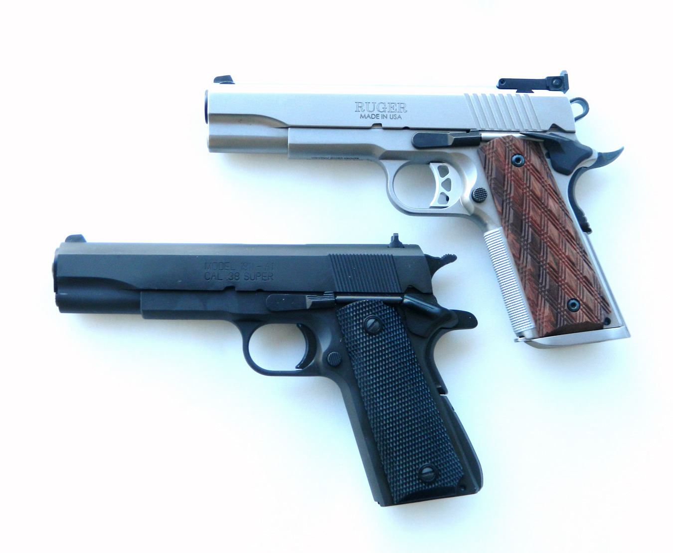 Ruger 10mm, top, and Springfield .38 Super pistol, bottom,