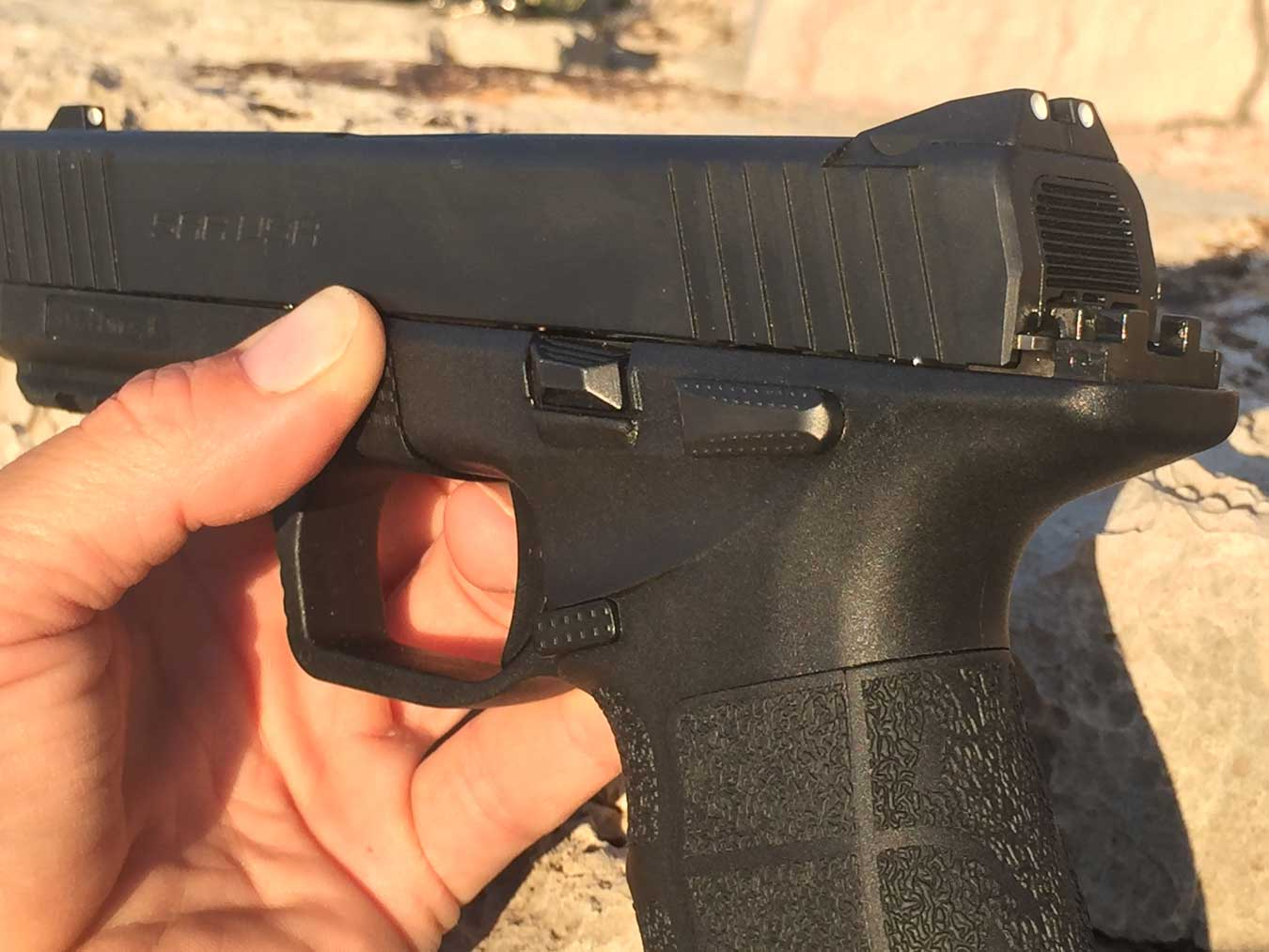 textured grip and takdown button on the Sarsilmaz SAR 9