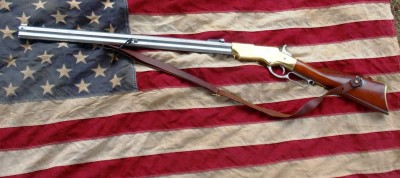 Henry lever action rifle over an American flag