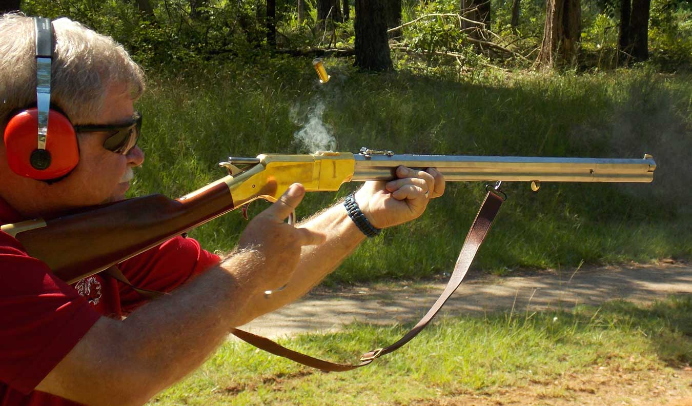 Firing a lever-action Henry rifle with a spent case and smoke in the air